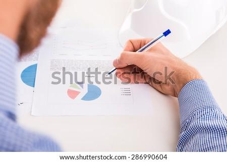 Man checks the company documents at your desk - studio shoot