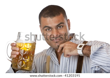 Man cheers with Oktoberfest beer stein into camera. Isolated on white.