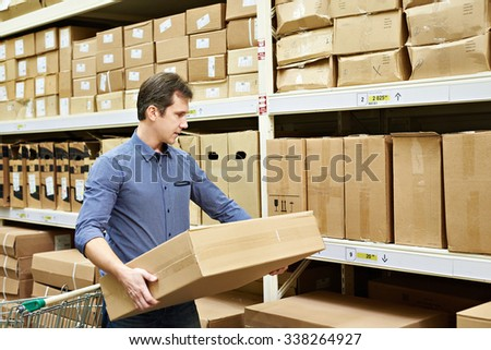 Man chooses a box of goods in stores