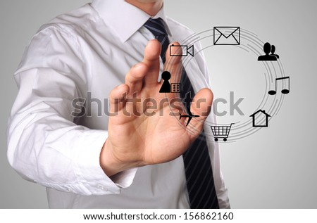man chooses a interaction on the internet, such as playing game, chatting, looking for a house and so on