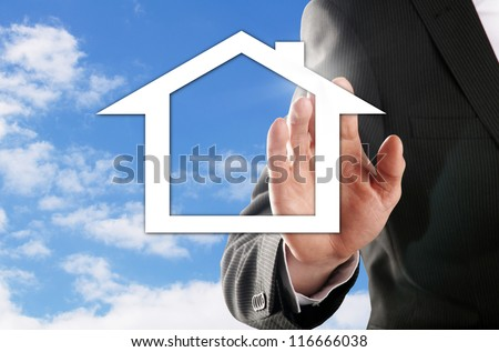 man chooses his dream house in front of the blue sky