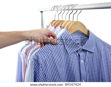 man choosing and taking his shirt isolated on white background