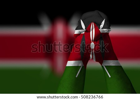 Man clasped hands patterned with the KENYA flag