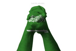 Man clasped hands patterned with the SAUDI ARABIA flag