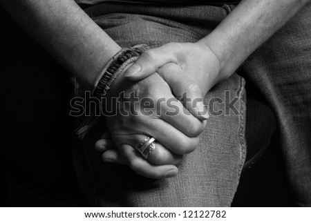 stock photo : Man clasping his hands together in black and white