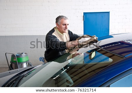 Man cleaning a car.