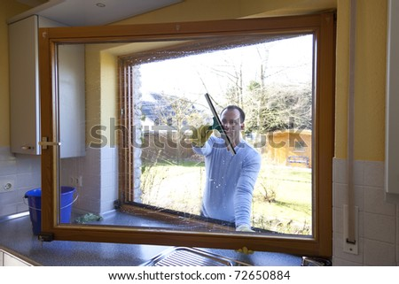 man cleaning a window at home. spring cleaning.