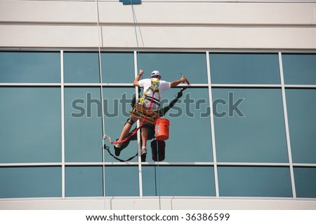 Man Cleaning Office Building