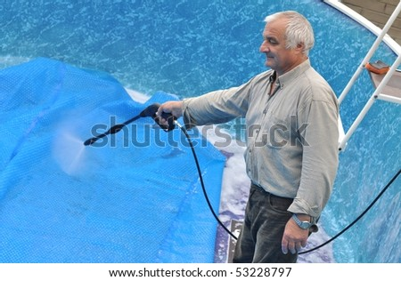 Man cleaning pool