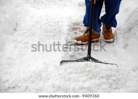 Man cleaning snow from a walkway with copy space