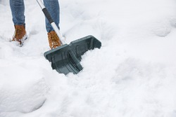 Man cleaning snow with shovel outdoors, closeup