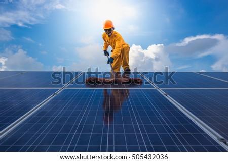 man cleaning, solar power washing