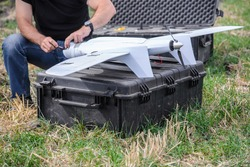 Man cleans the lens of military drone/Military drone