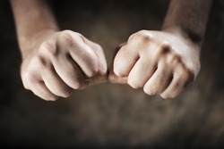 Man clenching his hands to fists.