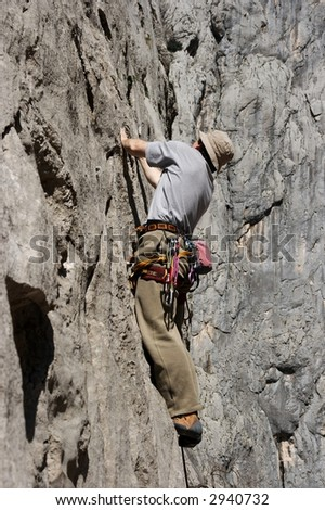 Man climbing a rock wall in paklenica national park