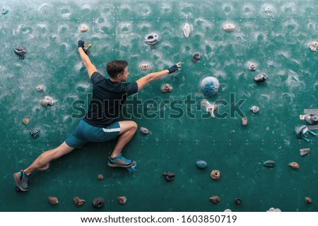 Man climbing bouldering problem. Rock-climbing. Climbing icon. Man climbing on wall. Climbing background.