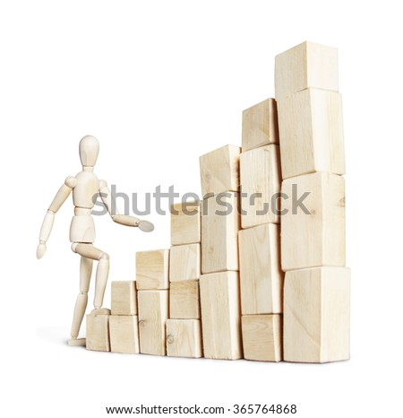 Man climbing to high stack of blocks. Abstract image with a wooden puppet #365764868