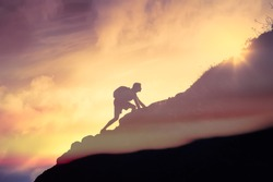 Man climbing up a mountain. Motivation, and inspiration concept.