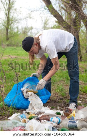 man collecting rubbish in the forest