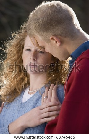Man Comforting A Woman