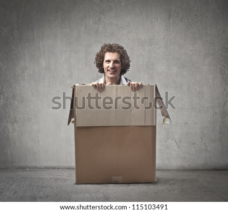 Man coming out from a box