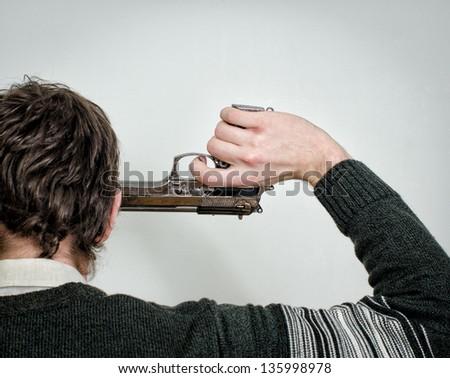 Man commit suicide. Back view