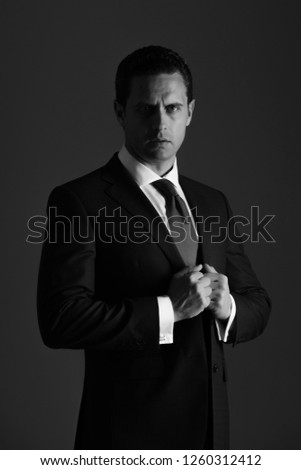 6b47b96fa man. confident businessman or successful boss adjusting tie in fashionable blue  formal suit and white