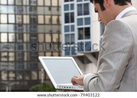 Man connecting to Internet outdoors
