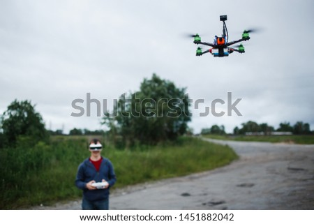 Man controlling custom made dron by virtual reality glasses.