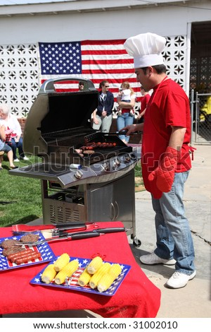 Man cooking at a 4th of July Barbecue