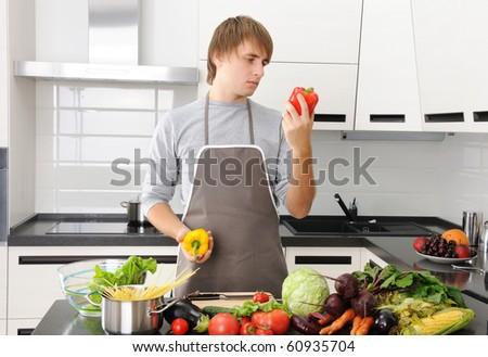 Man cooking in modern kitchen - stock photo