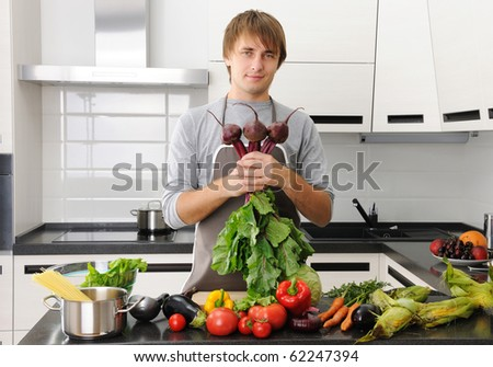 Man cooking in modern kitchen healthy vegetables