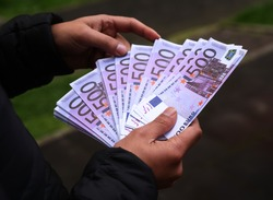Man Counting Euro Notes
