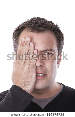 man covering his eye with his hand
