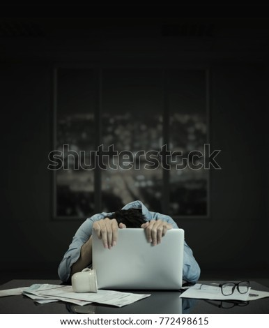 Man crawling on computer laptop, with building window