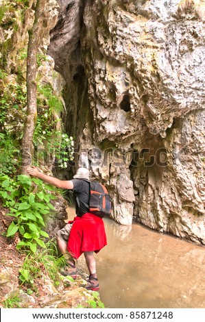 man crossing a valley, man in the forest close to a valley