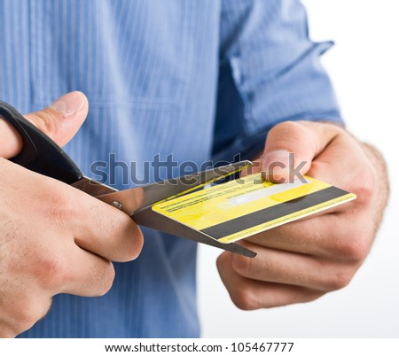 Man cutting a credit card