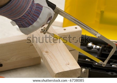 man cutting board with a saw