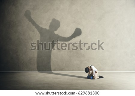 man defeated by his shadow boxing Foto d'archivio ©