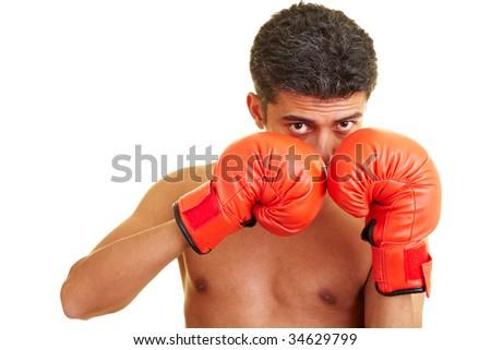 Man defending himself while boxing