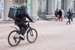 man delivers pizza on a Bicycle