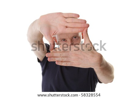 man designer creates a frame with her hands. Focus on hand - stock photo
