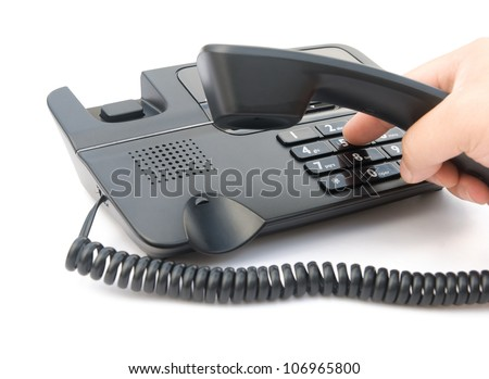 man dialing a black telephone with clipping path