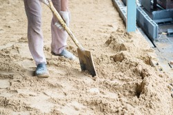 man digging in the ground with shovel and spade.