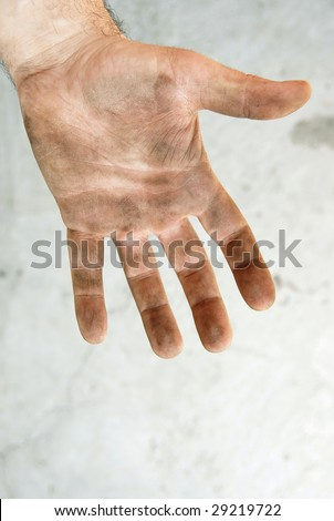 man dirty hand closeup isolated on gray background