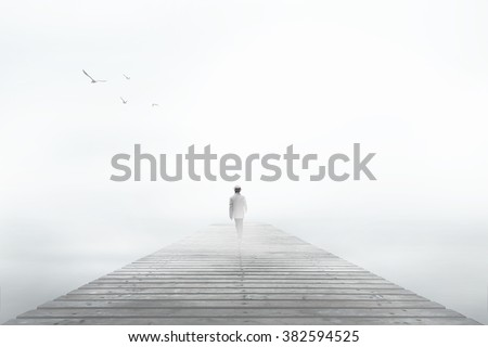 Man disappearing in the white fog