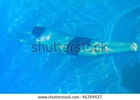 Man diving deep underwater