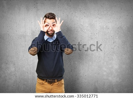 man doing a glasses sign #335012771