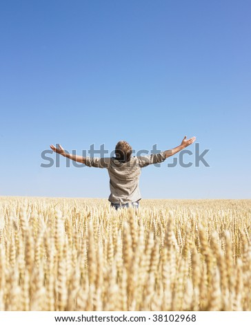 Man doing a top of the world in wheat field