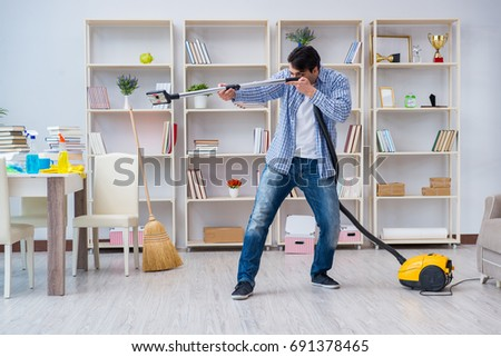 Man doing cleaning at home #691378465